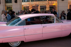 Tim Matheus (in black shirt standing near windshield) and his pink Caddy on the Bass Hall sidewalk.